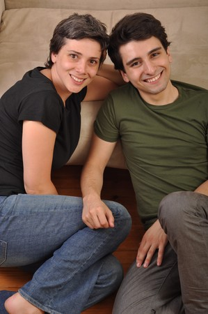 lovely friendship between sister and brother lying and relaxing on the floor next to couch Stock Photo - 7377762