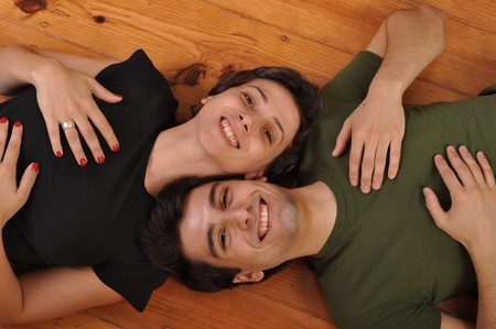 lovely friendship between sister and brother lying and relaxing on the floor photo