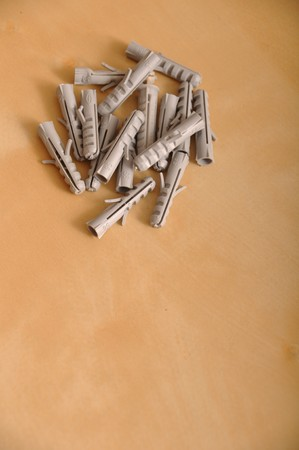 capping: pile of plastic straddling dowels on a brown wooden background Stock Photo