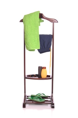 man beach clothing on a wooden hanger with  towel, swimsuit, sun lotion, sunglasses and flip-flops (isolated on white background) Stock Photo - 7508092