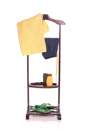 man beach clothing on a wooden hanger with  towel, swimsuit, sun lotion, sunglasses and flip-flops (isolated on white background) Stock Photo - 7508094