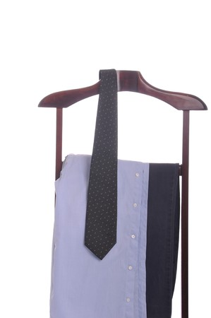 business man clothing on a wooden hanger with shirt, tie and trousers (isolated on white background) Stock Photo - 7508097