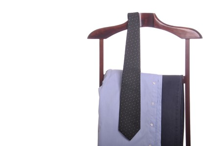business man clothing on a wooden hanger with shirt, tie and trousers (isolated on white background) Stock Photo - 7508091