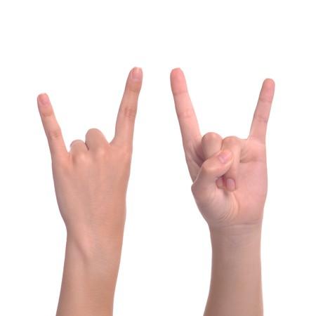 rock hand: donna mano dando il gesto di corna del diavolo (isolato su sfondo bianco)  Archivio Fotografico
