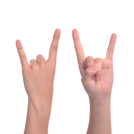 rock   roll: woman hand giving the devil horns gesture (isolated on white background) Stock Photo