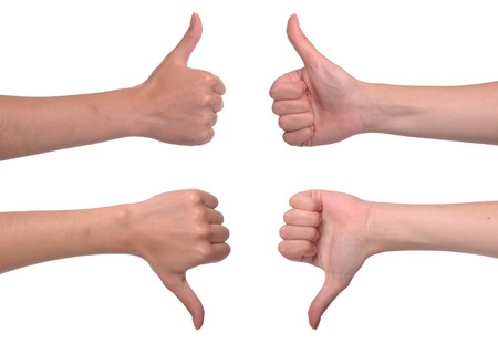 up and down: front and back woman hands showing thumbs up and down (isolated on white background)