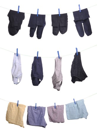 briefs: man underwear (socks, underpants, boxers) on a washing line (isolated on white background)