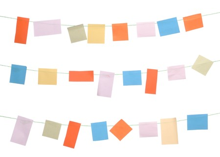 set of colored sticky notes hanging on wire (isolated on white background) photo