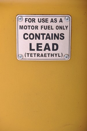contains lead vintage sign on a yellow gas pump background photo