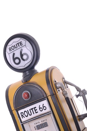 copy of a yellow vintage route 66 fuel pump isolated on white background photo