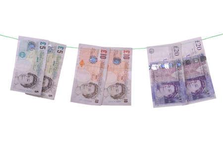 money laundering: concetto di riciclaggio con note di libbra (isolati su sfondo bianco)  Archivio Fotografico