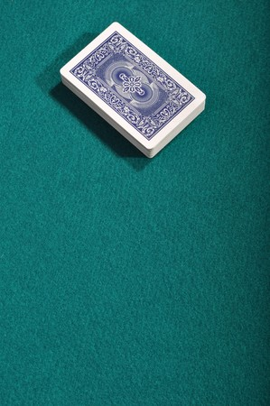 playing cards deck on a green cloth background