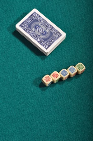 poker cards and dices on a green cloth background Stock Photo - 7561546