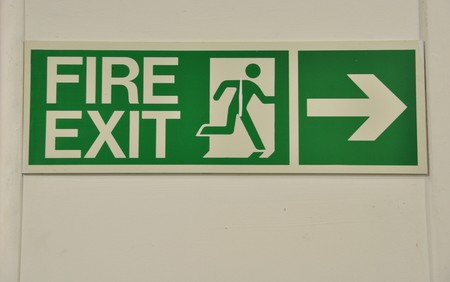 green and white fire exit sign (guidance to wayout) photo