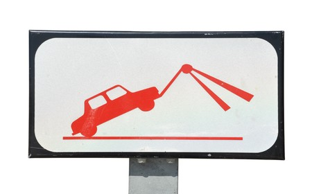 traffic towing sign isolated on white background photo