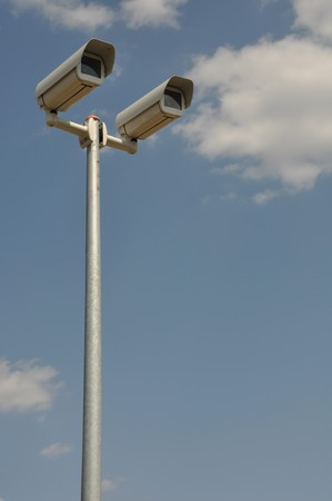 video surveillance cameras against blue sky background Stock Photo - 7783356