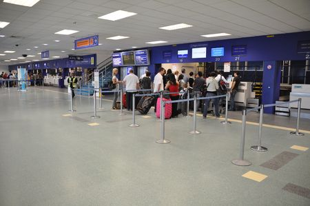 airport security: CARDIFF - AUGUST 21 2010: passengers at Cardiff airport at check-in desks on August 21, 2010 in Cardiff, UK