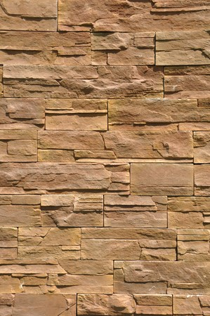 vibrant brown background of a stone wall photo