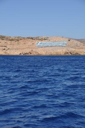 védekező: national flag on a greek island (defensive territory from Turkey invasions) Stock fotó
