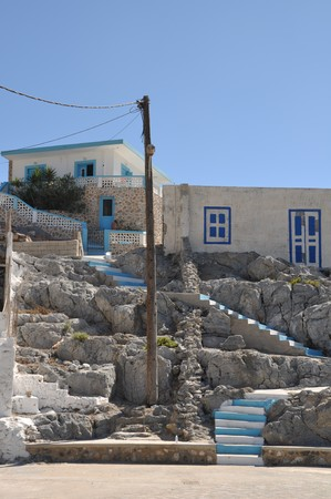 beautiful greek scene with blue and white stairs and house (Pserimos island) Stock Photo - 8298089