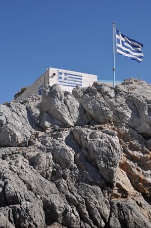 gorgeous greek house and flag on the stones of Pserimos island Stock Photo - 8298064