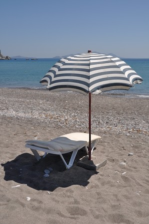 gorgeous beach scene with greek umbrella and chair at Kefalos beach (Kos), Greece Stock Photo - 7917110
