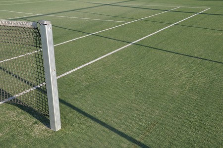 tennis stadium: white lines on an outdoor tennis court (artificial grass)
