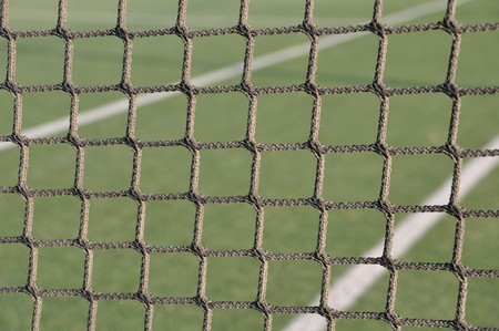 green outdoor tennis court net (background) photo