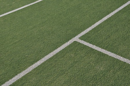 tennis courts: white lines on an outdoor tennis court (artificial grass)