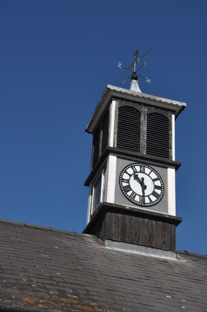 clock tower with weather vane on top of a building in Gloucester, England photo