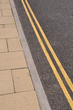 double yellow lines on the asphalt road (forbidden parking) photo