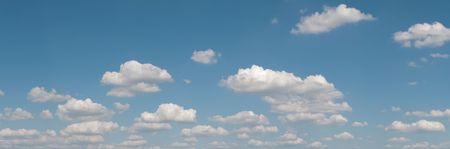 cloudscape: gorgeous white clouds in the blue sky (panoramic picture with copy-space at left top corner) Stock Photo