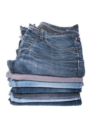 stack of various jeans isolated on white background Stock Photo - 8355239