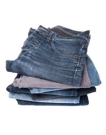 stack of various jeans isolated on white background photo
