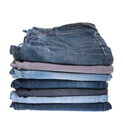 stack of various jeans isolated on white background Stock Photo