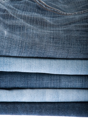 stack of blue jeans isolated on white background photo
