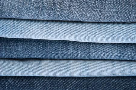 jeansstoff: Stack of Blue Jeans als Hintergrund oder Textur Lizenzfreie Bilder