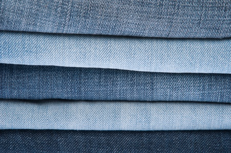 stack of blue jeans as a background or texture