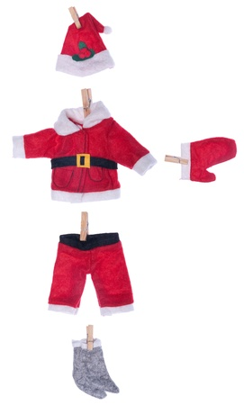 Santa Claus clothes on white background (hat, coat, pants, glove, socks) Stock Photo - 8402551