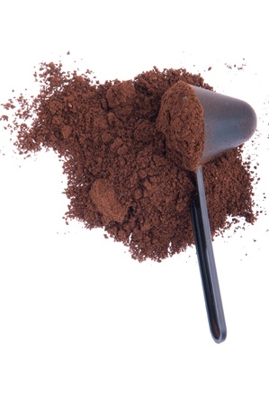 grinded: fresh coffee powder with spoon isolated on white background