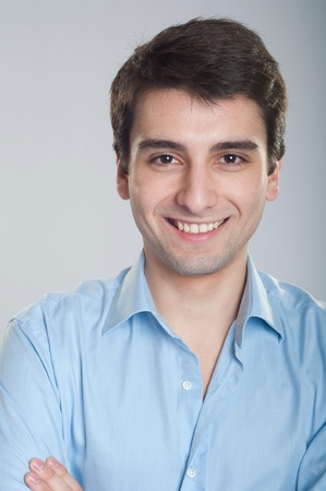 portrait of a smiling handsome trainee starting business career photo