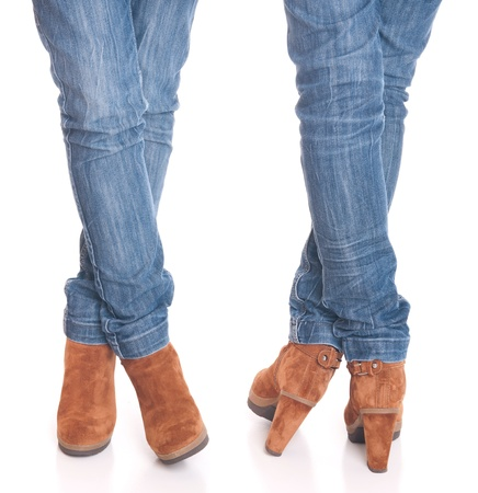 legs in jeans wearing leather fashion boots isolated on white background (front and back posing) photo