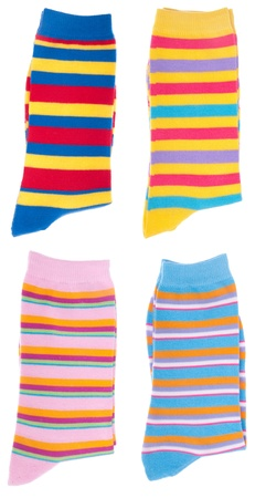 bright and colorful pairs of socks isolated on white background photo
