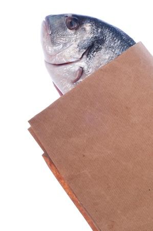 raw dorado fish on market paper bag (isolated on white background) Stock Photo - 8627393