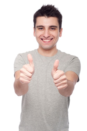 handsome young man with thumbs up on an isolated white background Stock Photo - 8818351