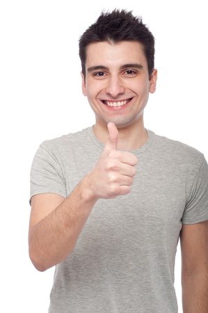 handsome young man with thumbs up on an isolated white background Stock Photo - 8818383
