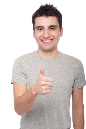 handsome young man with thumbs up on an isolated white background photo