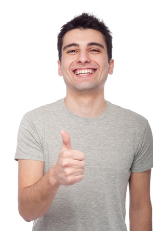 handsome young man with thumbs up on an isolated white background Stock Photo - 8818384