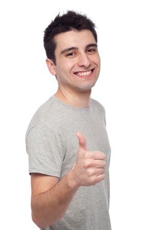 handsome young man with thumbs up on an isolated white background Stock Photo - 8818340