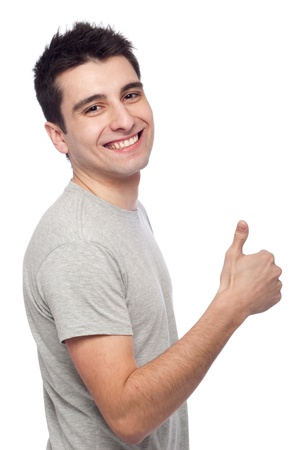 handsome young man with thumbs up on an isolated white background Stock Photo - 8818342